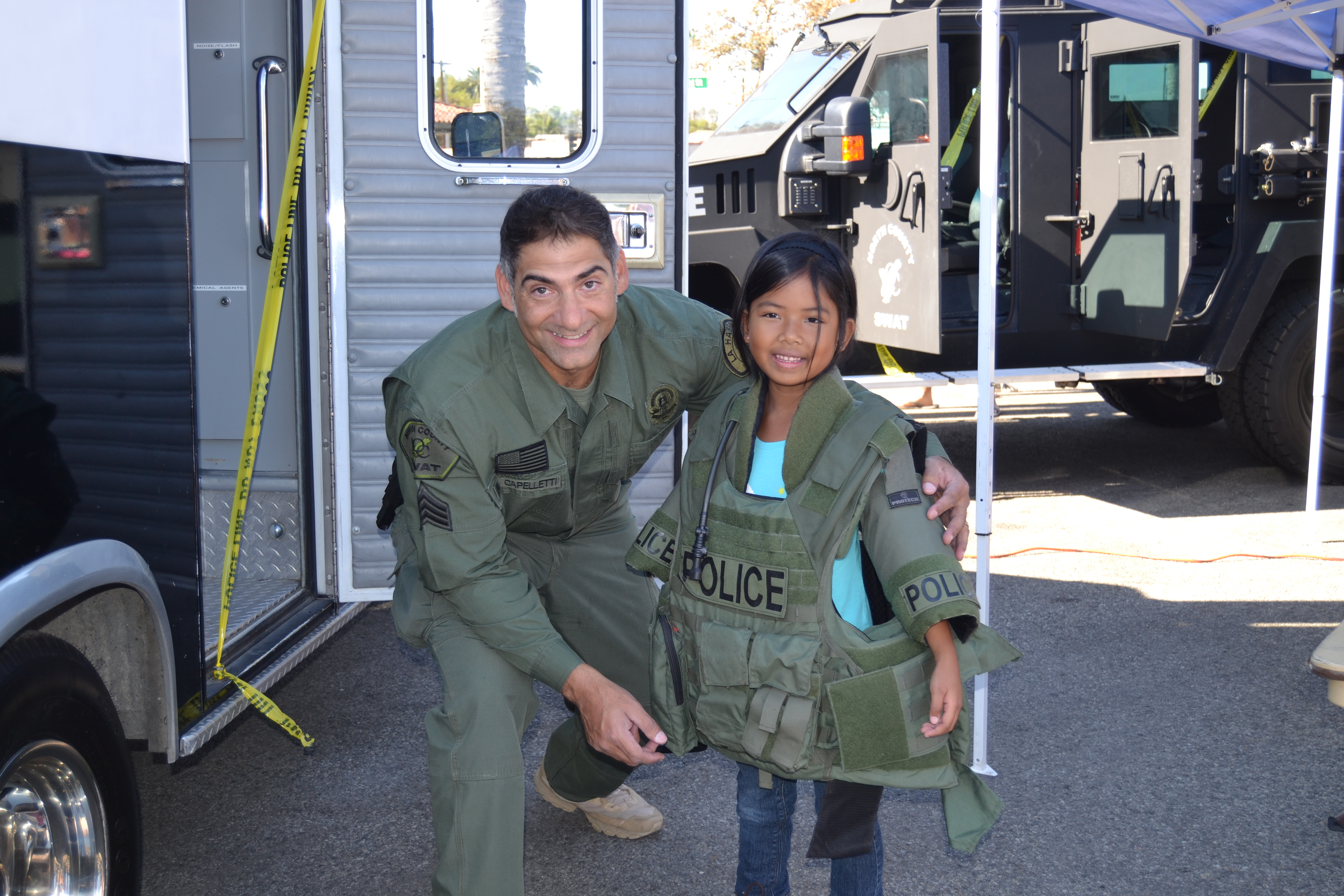 Police officer and young girl with Police Vest on