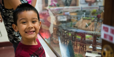 Little Boy at Train Model