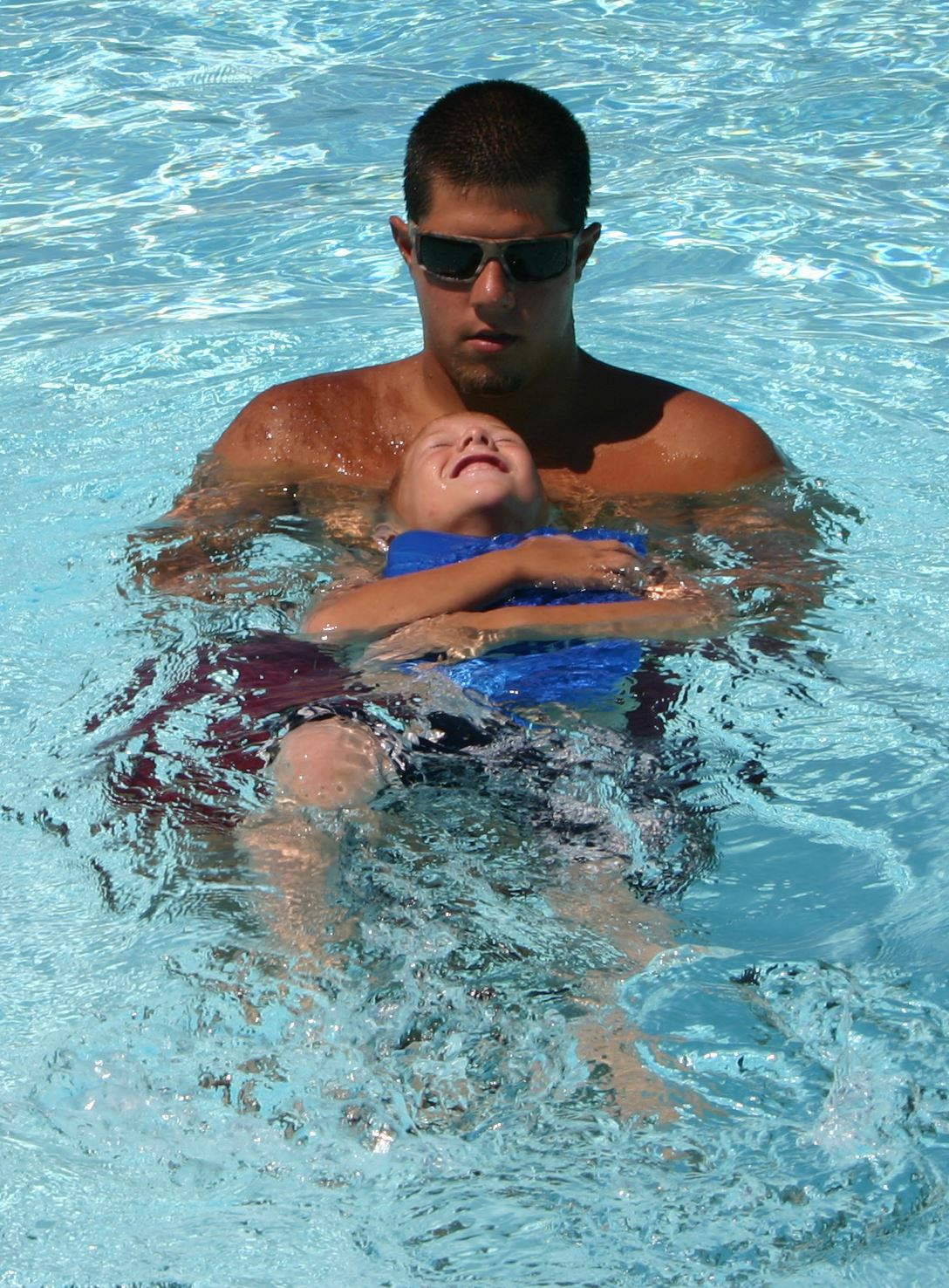 Swim instructor and child during swim lesson